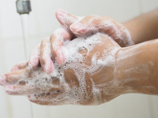 Thorough hand washing and use of alcohol-based hand sanitizer with at least 60% alcohol help prevent spread of the coronavirus.