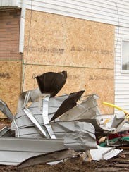 Damage to the side of a home shown Tuesday, Oct. 24,