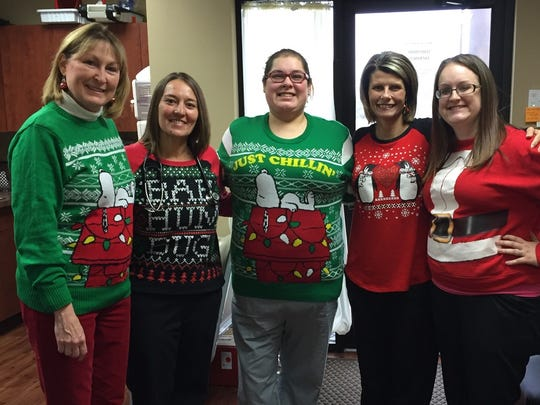 Ugly sweater lunch An ugly sweater holiday pitch in lunch at Dr. John Reid's office brought out some of the season's  least attractive but fun holiday attire. In the photo from left are Susan Reid, Jennifer Miles, Samantha Rodriguez, Stacy Summers and Katelyn Lehman.