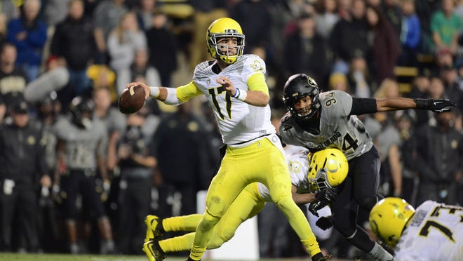 Oct 3, 2015; Boulder, CO, USA; Oregon Ducks quarterback Jeff Lockie (17) prepares to pass in the second quarter against the Colorado Buffaloes at Folsom Field. Mandatory Credit: Ron Chenoy-USA TODAY Sports