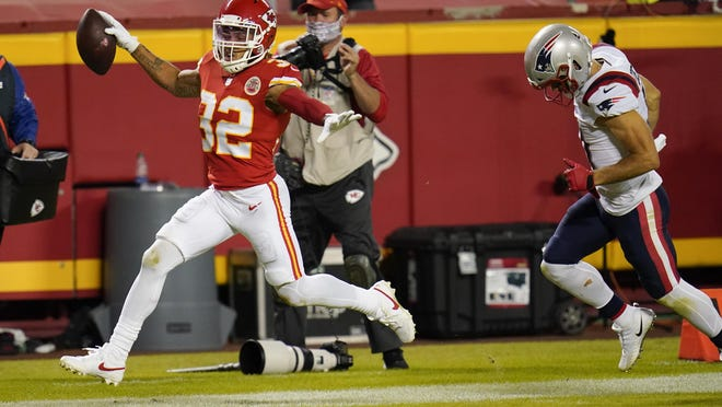 Kansas City Chiefs safety Tyrann Mathieu (32) runs from New England Patriots wide receiver Julian Edelman, right, while returning an interception 25-yards for a touchdown during the second half on Oct. 5, 2020, in Kansas City.