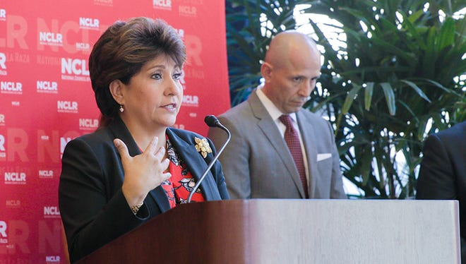 Janet Murguía, president and CEO of the National Council of La Raza, talks about the impact and history of the Latino community in Arizona during a news conference in downtown Phoenix on Oct. 7, 2016.