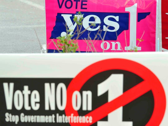 Amendment 1 signs line the drive at Howard Office Building in downtown Nashville, Tenn. October 18, 2014.