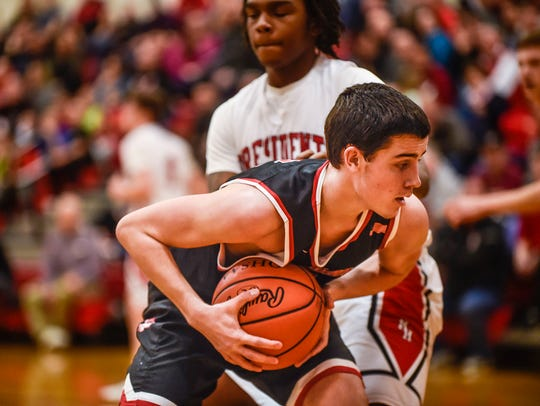 Pleasant's Gage Williams holds the ball low and waits
