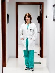 Dr. Jennifer Maddron poses for a portrait at her practice