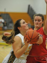 Colonel Crawford's Lydia Strouse goes up for a layup.