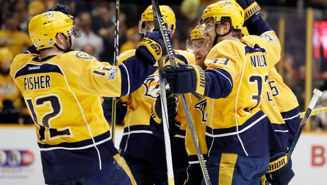 The Predators celebrate Ryan Ellis' first of two goals Monday in their victory against the Coyotes.