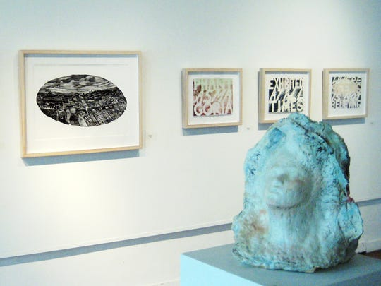 Ruth Reese's sculpture is in the foreground and Susanna Crum's prints in the background at the New Harmony Gallery of Contemporary Art's Mercatus exhibit up through July 21.