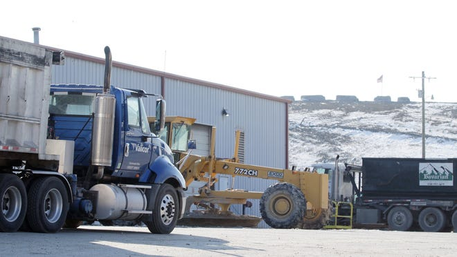 "A truck arrives at the Bavarian Waste Services landfill. Odor complaints about the facility have increased dramatically the past few years after Bavarian began accepting greater quantities of what is called ""special waste,"" including sewage sludge and oil drilling mud."