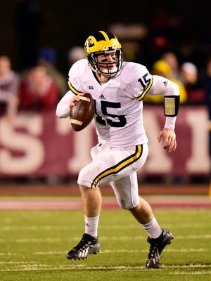 Nov 14, 2015; Bloomington, IN, USA;  Michigan Wolverines quarterback Jake Rudock (15) looks for to pass the football during the second half at Memorial Stadium.  The Michigan Wolverines defeated The Indiana Hoosiers in overtime 48-41.