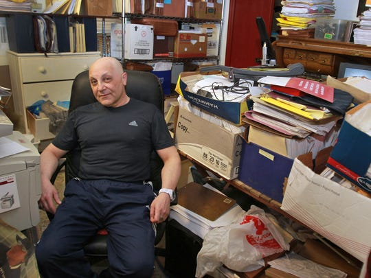 Gersh Zavodnik poses in a room in his home, Tuesday, May 14, 2013, that is full of files for the vast number of lawsuits he has filed.