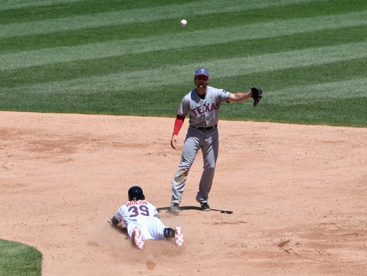 Chicago White Sox's Alen Hanson (39) steals second base as Texas Rangers second baseman Pete Kozma (38) waits for the throw during the third inning of a baseball game, Sunday, July 2, 2017, in Chicago. (AP Photo/David Banks)