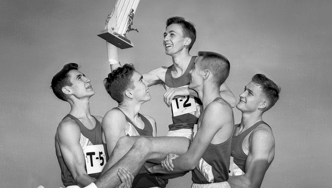 Treadwell's Ralph Thompson (center) is hoisted along with the first place trophy by team members Phillip King (left), Garry Thomas (second left), Warner Lester (second right) and Robbie Robinson (right) after Thompson led the team to its second straight state cross country title on Dec. 6, 1952, at Audubon Park.