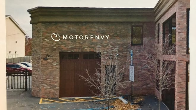 The owner of MotorEnvy in Hasbrouck Heights is moving the luxury auto leasing company to 317 Wanaque Ave. This architectural rendering presented to borough officials shows the design of the building sign for the site.