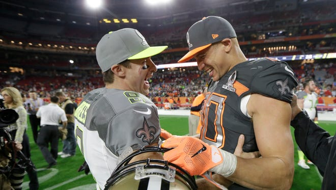 QB Drew Brees, left, and TE Jimmy Graham were already wearing different uniforms at the Pro Bowl.