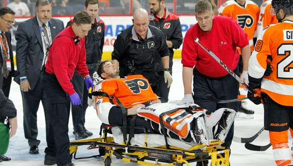 Philadelphia Flyers goalie Michal Neuvirth is taken