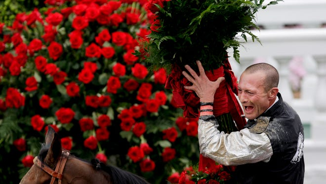 Calvin Borel celebrated in the winner's circle after he road Mine That Bird to win the Kentucky Derby at Churchill Downs.(By Sam Upshaw Jr., The Courier-Journal)May 2, 2009