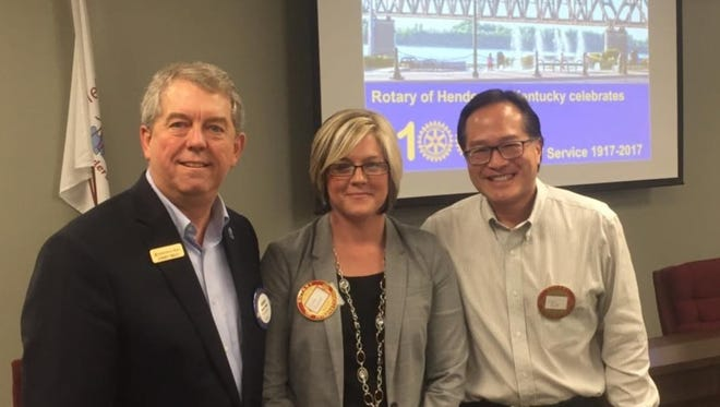 """As Henderson Rotary Club begins its 100th year of """"Service Above Self"""" earlier this year, the members were also able to welcome their 99th and 100th local members. From left to right are Henderson Rotary President Dorsey Ridley, Lori Cravens Tuggle and Eric Hoey."""