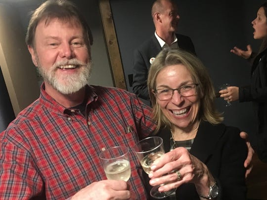 Kitsap Regional Library Director Jill Jean celebrates passage of the library levy Tuesday with her partner Charlie Merrill at Toro Lounge in Bremerton.