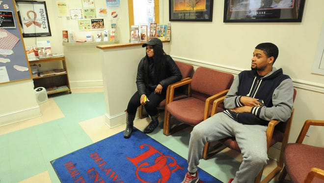 Delaware State University sophomores Felicia Cruel (left) and Marcus Wing waitto be seen at the Student Health Center at Delaware State University in Dover.