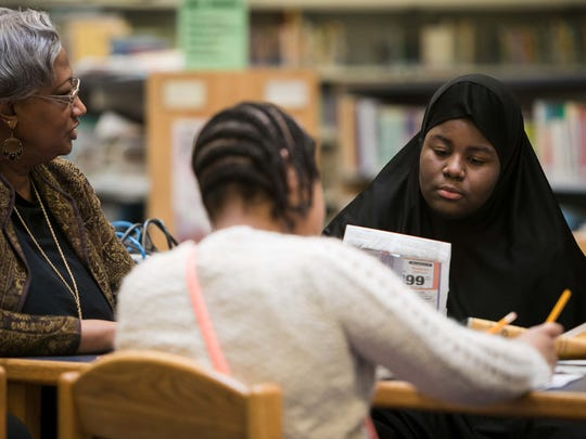 Jazmin Brown (right) and her fifth-grade classmates gather in the library at Bancroft Elementary School to discuss story ideas for the next issue of their school newspaper, the Bancroft Banner.