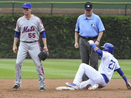 Chicago Cubs shortstop Addison Russell (27) slides safely into second base with a two-RBI double as New York Mets second baseman Kelly Johnson (55) stands nearby during the first inning at Wrigley Field on Wednesday.
