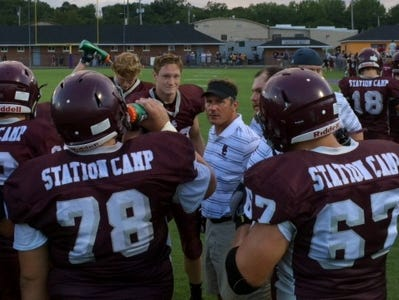 Station Camp head coach Shaun Hollinsworth talks to his team during a break in action during Friday's Tobacco Bowl Jamboree