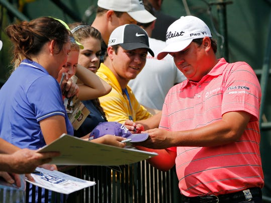 Jason Dufner signs autographs after on the eighth hole during a practice round for the PGA Championship golf tournament at Valhalla Golf Club on Tuesday, Aug. 5, 2014, in Louisville, Ky. The tournament is set to begin on Thursday. (AP Photo/Mike Groll)