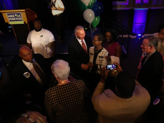 Developer Mike Purzycki mingles with the crowd after announcing his candidacy at the Chase Center on the Riverfront Wednesday.