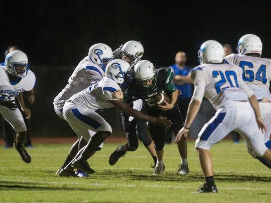 Gateway Charter defense closes in on St. John Neumann offense at St. John Neumann High School in Naples on Tuesday, Oct. 24, 2017.