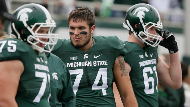 Michigan State offensive tackle Jack Conklin (74) watches warmups before the first half of an NCAA college football game against Indiana, Saturday, Oct. 24, 2015, in East Lansing, Mich