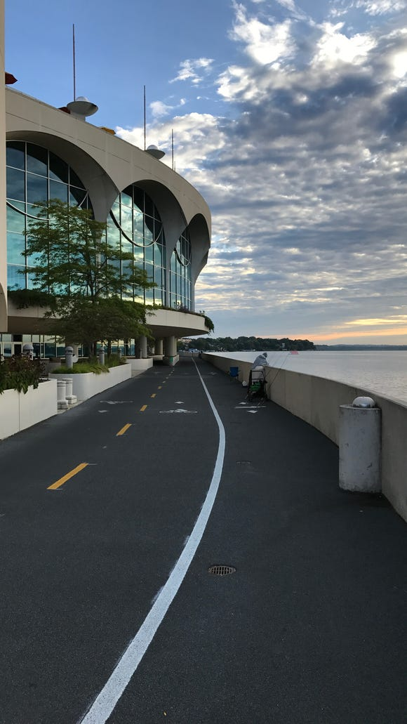"""A cycling and pedestrian path runs past the Monona Terrace in Madison. Frank Lloyd Wright designed the building to be a """"dream civic center"""" in 1938."""