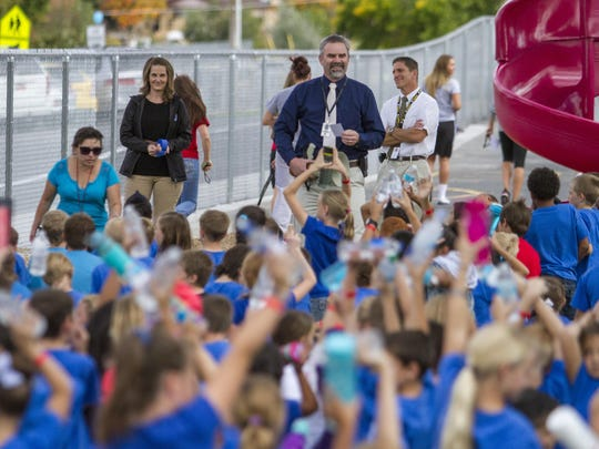 Principal Mike Moyle and Cedar City Mayor Maile Wilson address students before the East Elementary Walk-a-thon, Friday, Oct. 16, 2015.