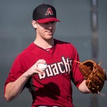 Feb. 20, 2014 - The Diamondbacks' Zeke Spruill warms up during practice at the team's spring training facility at Salt River Fields.