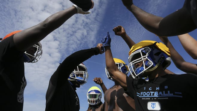 Football teams across the state opened practice Monday July 27, 2020, to prepare for the 2020 season. The Alabama High School Athletic Association decided to push ahead with preparations for football despite concerns over COVID-19. Defensive players huddle during practice at Tuscaloosa County High.