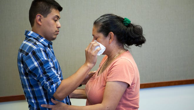 Steve Hernandez wiping a tear from his mother Maria Mancia's face as they are reunited for the first time since 1995 at the District Attorney's office in San Bernadino, California June 9. Hernandez was abducted by his father Velentin Hernandez in 1995 when he was just 18 months old.