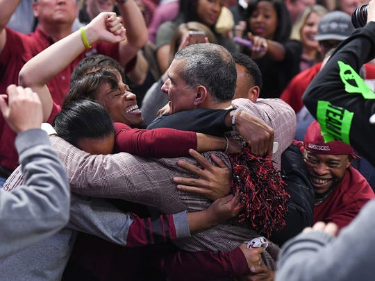 South Carolina head coach Frank Martin hugs his wife Anya after the Gamecocks defeated Duke 88-81 in the 2nd round of the NCAA Tournament at Bon Secours Wellness Arena in downtown Greenville on Sunday, March 19, 2017.