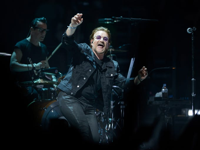 Drummer Larry Mullen Jr. and singer Bono perform with