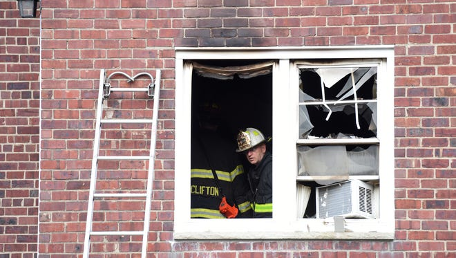 Members of the Clifton Fire Department respond to a fire at 65-91 Market St. in building 5 on Wednesday, May 23, 2018. The fire alarm sounded at approximately 7:40 am according to resident Alberto Juarez.