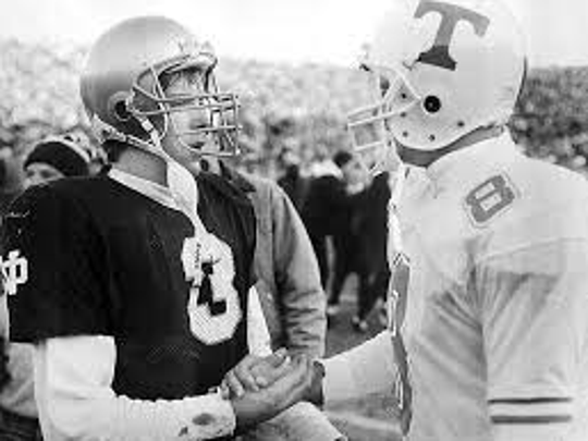 """Tennessee quarterback Andy Kelly shakes hands with Notre Dame's Rick Mirer after the """"Miracle at South Bend'' in 1991."""