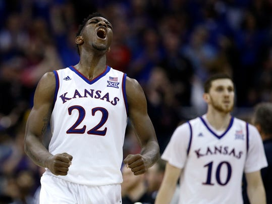 Kansas' Silvio De Sousa (22) celebrates during the second half of the NCAA college basketball championship game against West Virginia in the Big 12 men's tournament Saturday, March 10, 2018, in Kansas City, Mo. Kansas won 81-70. (AP Photo/Charlie Riedel)