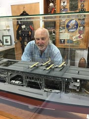 Chuck Baylis, Executive Director of the Military History Society of Rochester, looking over the model of the U.S.S. Langley