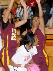 Plain Dealing's Jessica Carper (4) tries to get past
