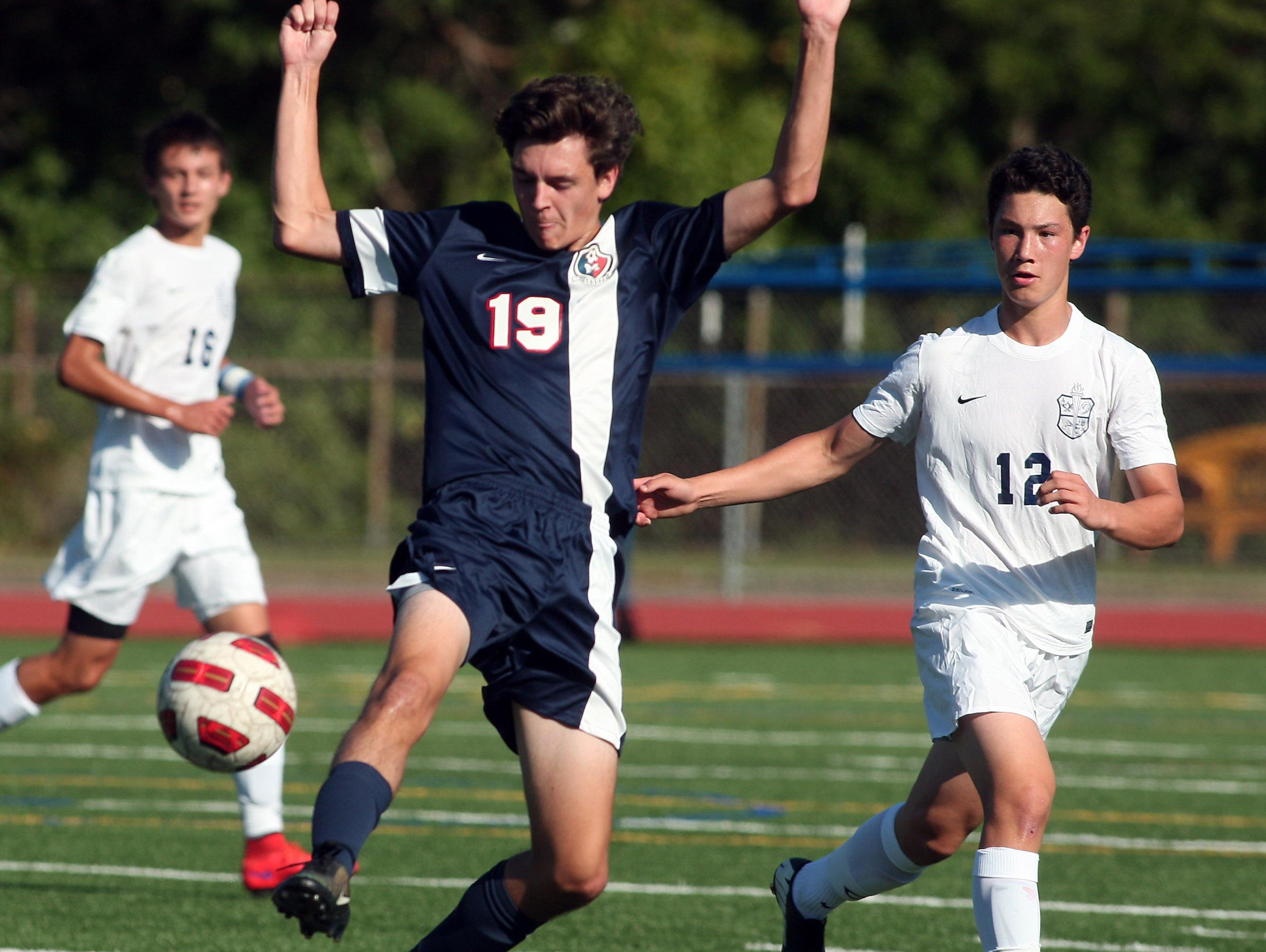 Mendham's Thomas Nobes controls the ball in front of Chatham's Harrison Shi in Wednesday's NJAC-United boys soccer matchup.