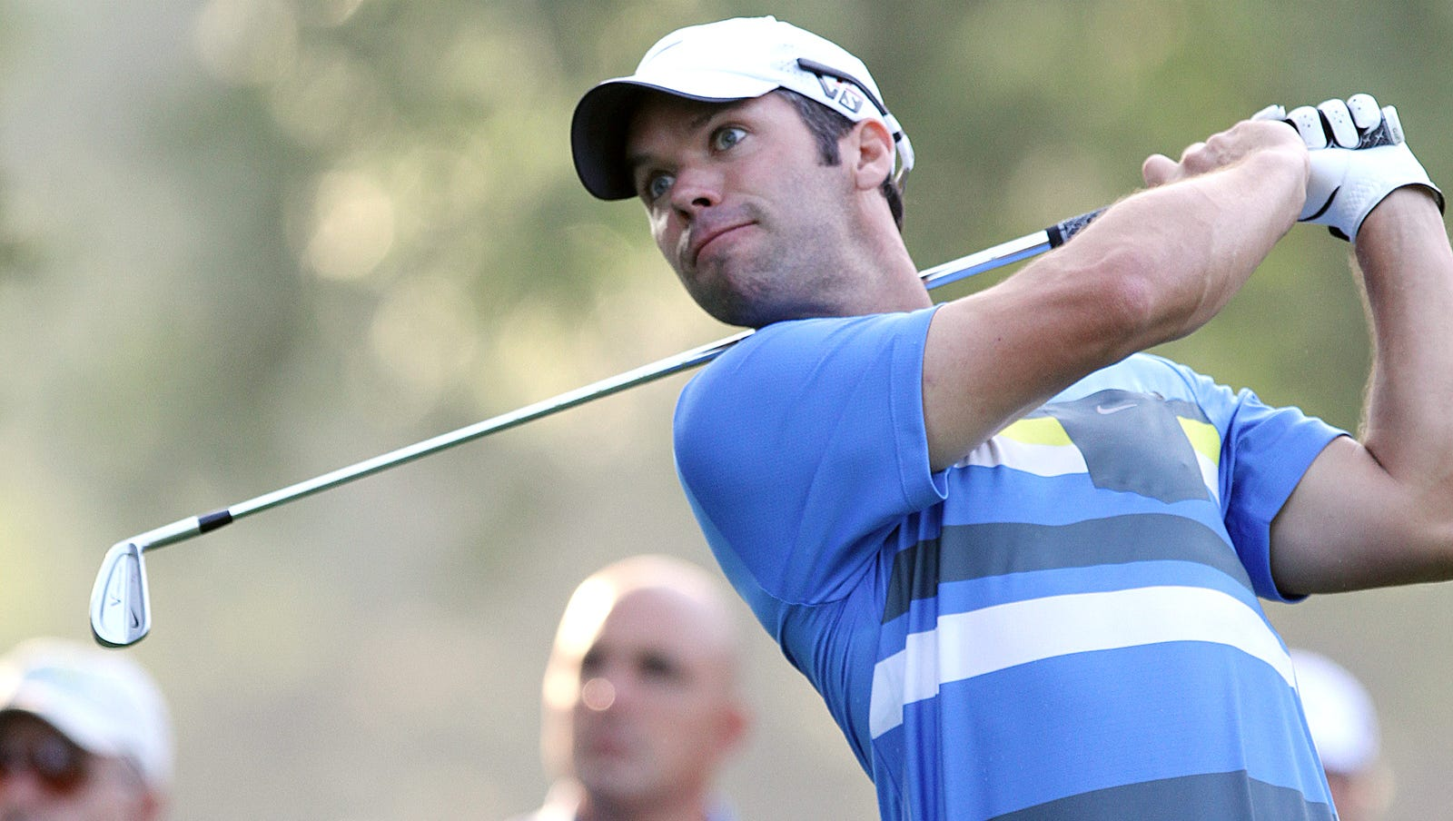 Paul Casey watches ball of the tee on 13.
