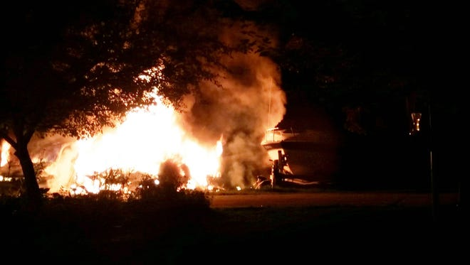 A fire being investigated as arson destroyed two cars, a boat and travel trailer.
