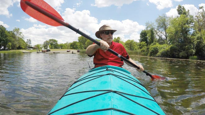 Former Livingston Daily managing editor Mike Malott, now sporting a beard he's grown since retirement, prepares for a kayak ride down the Mississippi River.