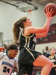 T.L. Hanna freshman guard Anna Ree Darby gets by Woodmont's Kitara Henry during the second quarter on Saturday at Westside High School in Anderson.