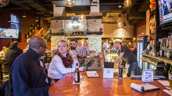 Patrons fill the bar at the Stone Balloon Ale House