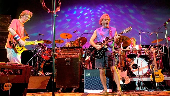 In this Aug. 3, 2002 file photo, members of the Grateful Dead, from left, Phil Lesh, Bill Kreutzmann, Bob Weir and Mickey Hart perform during a reunion concert in East Troy, Wis. The group  will perform three shows from July 3-5 at Soldier Field in Chicago.